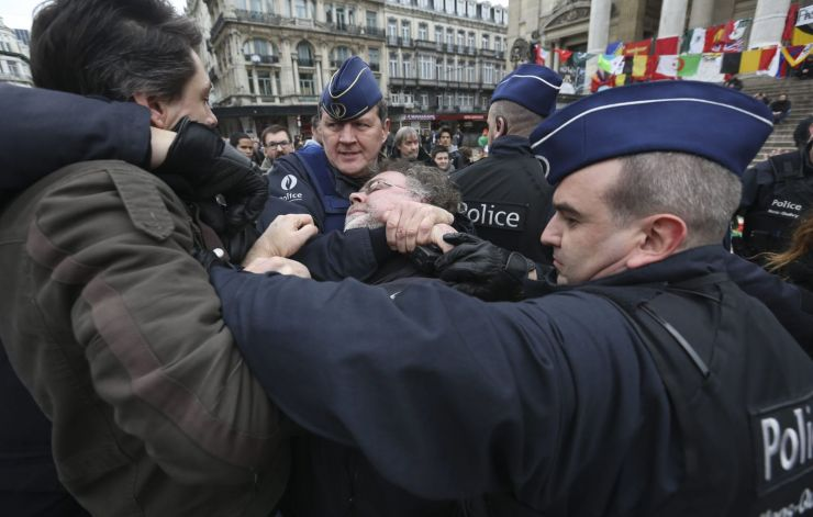 police arrest protestors at the Bourse Memorial as they protest against the calls for a far right-wing demonstration cancelled by Mayor before taking place in Molenbeek Brussels Belgium April 2 2016 EPA OL