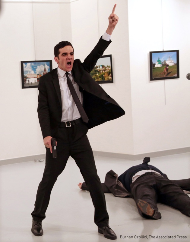 © Burhan Özbilici, Mevlüt Mert Altıntaş shouts after shooting Andrey Karlov, the Russian ambassador to Turkey, at an art gallery in Ankara, Turkey.