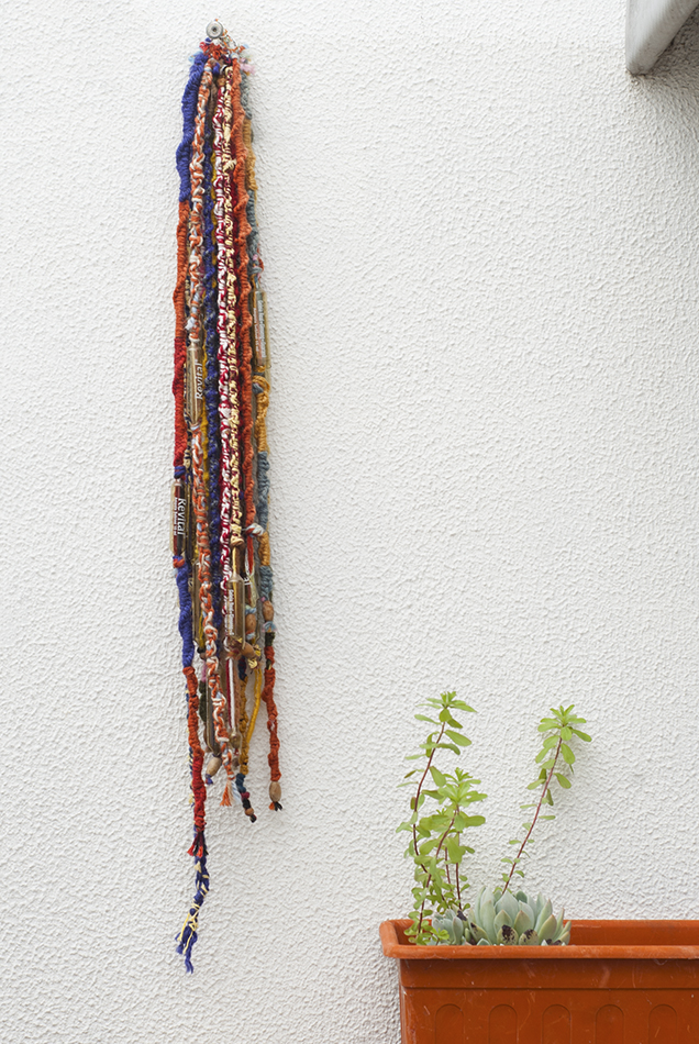 Pendant made out of old threads and vials. Sofia Silva, 2016.
